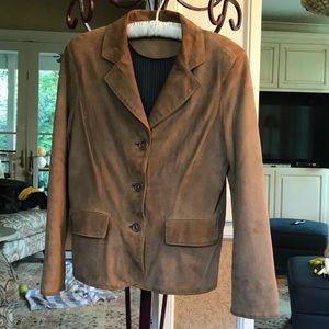 Italian leather jacket.  Black/Tan silk lining